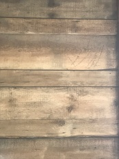 sanded brown on store wall